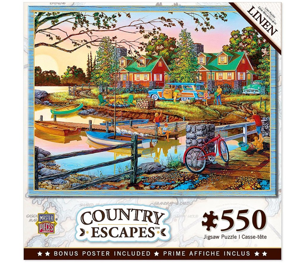 550 piece puzzle of a bridge overlooking water with boat dock and red cabins in background