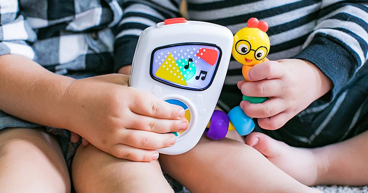 2 little kids with musical toy in their hands