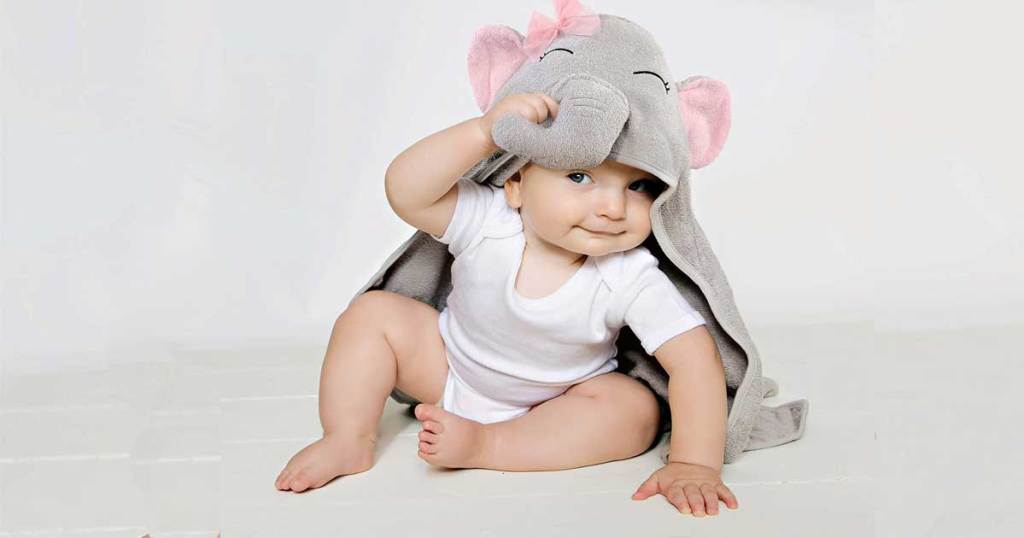 baby wearing a hooded elephant towel