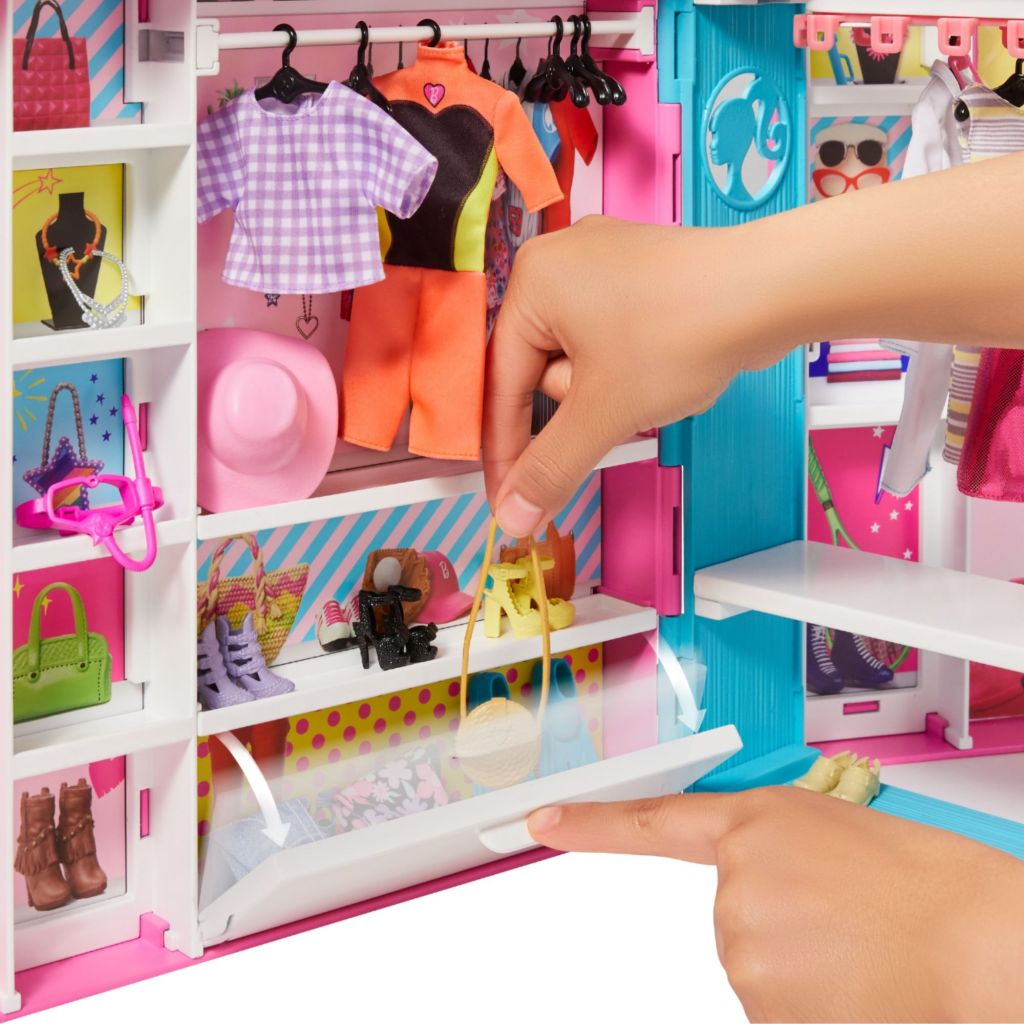 girl playing with barbie closet