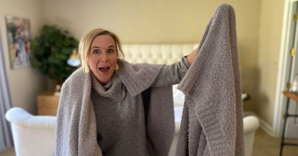 woman wearing soft blanket