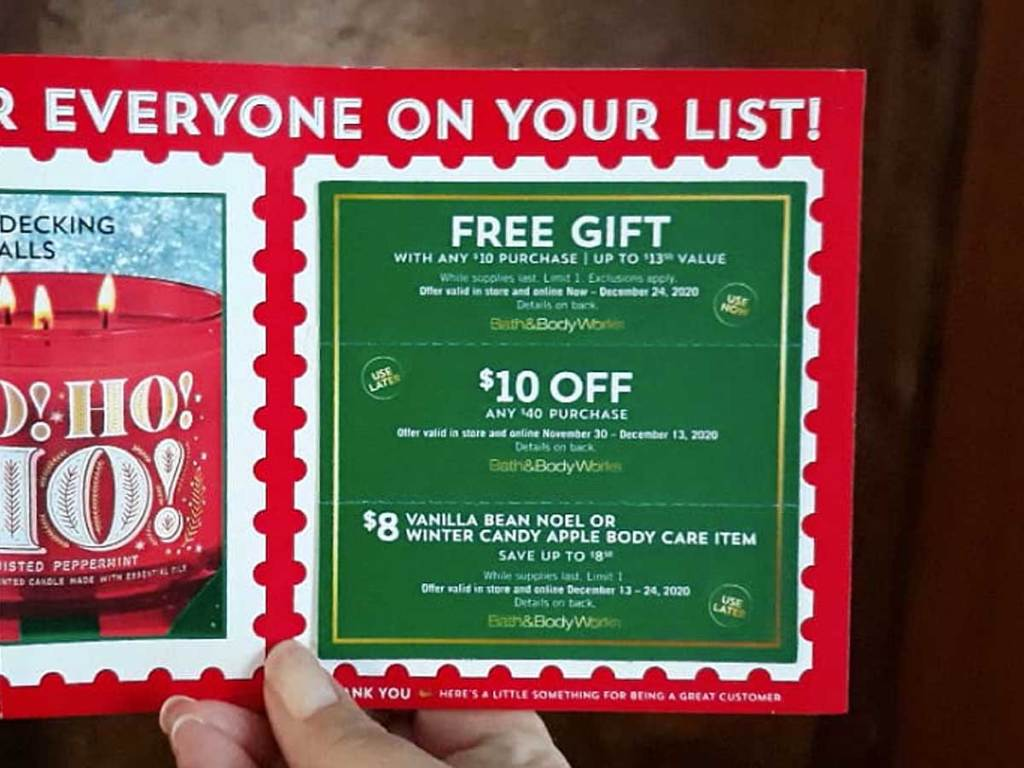 hand holding up a mailer for discounted store products