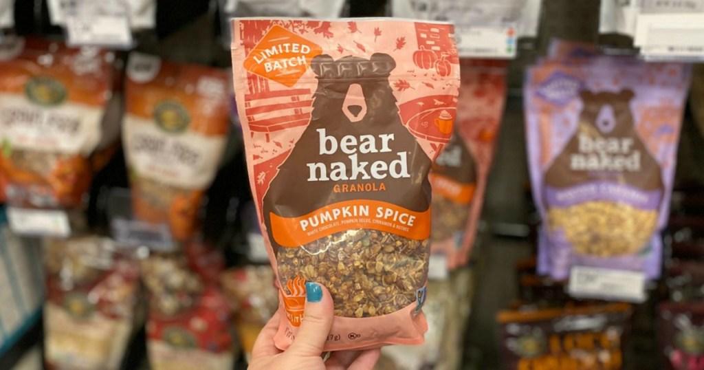 woman holding bear naked granola pumpkin spice