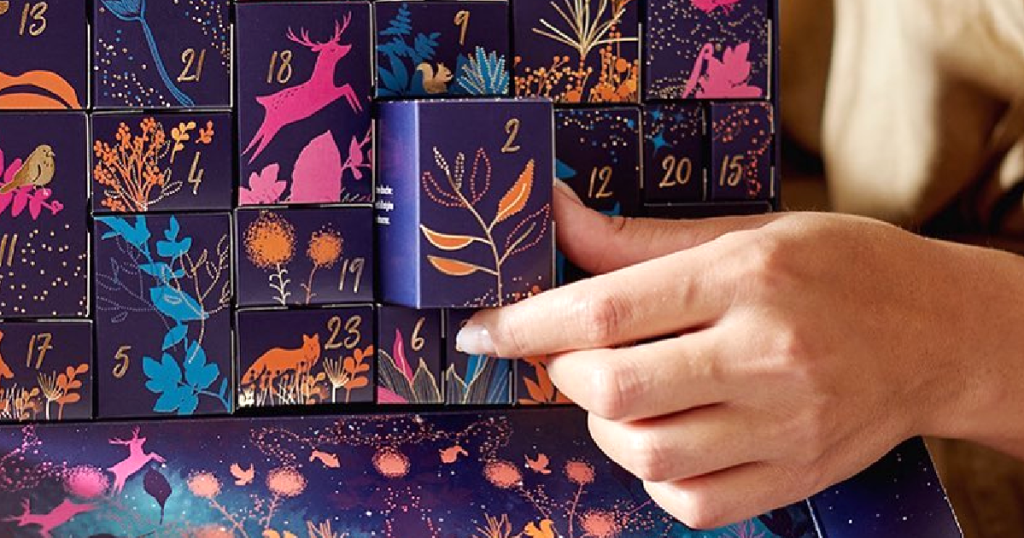 pulling out box from beauty advent calendar