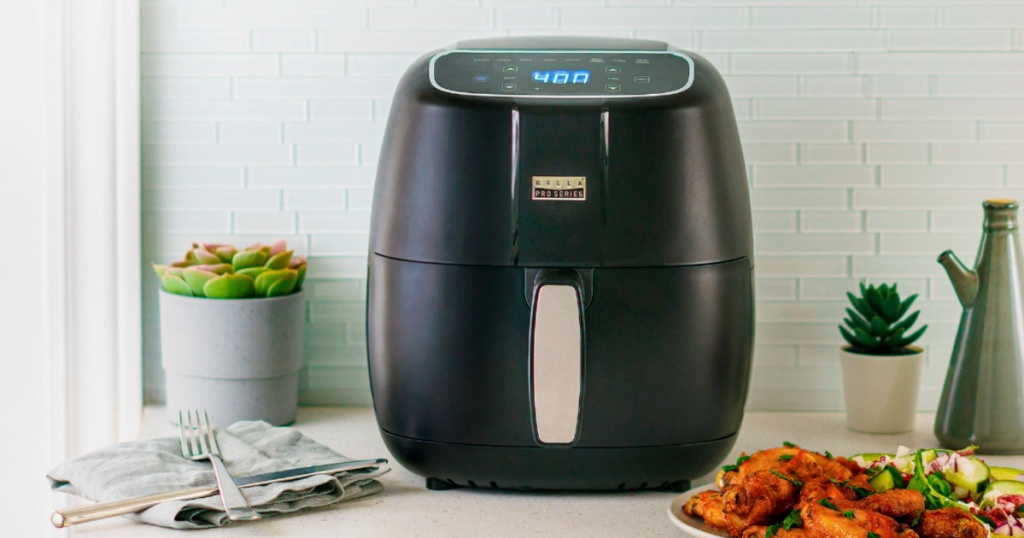 bella pro series air fryer on counter next to plate of food