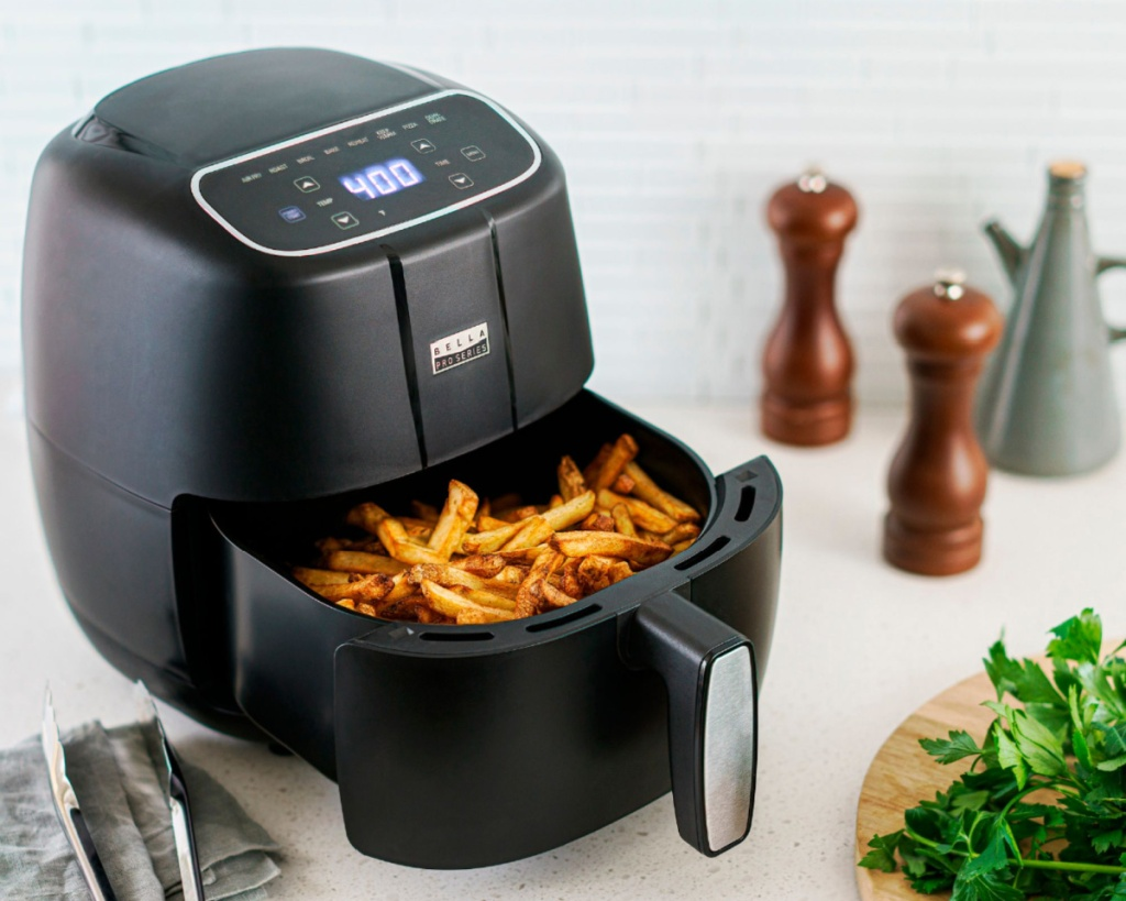 bella touch screen air fryer with open tray and food inside