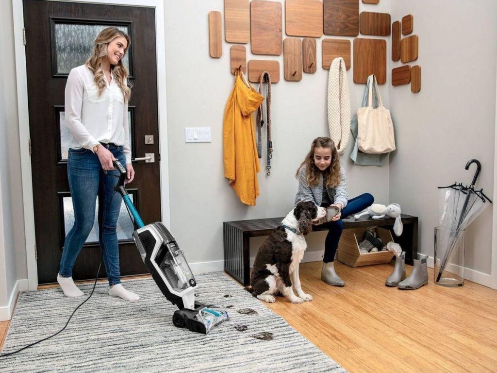 woman vacuuming dog hair