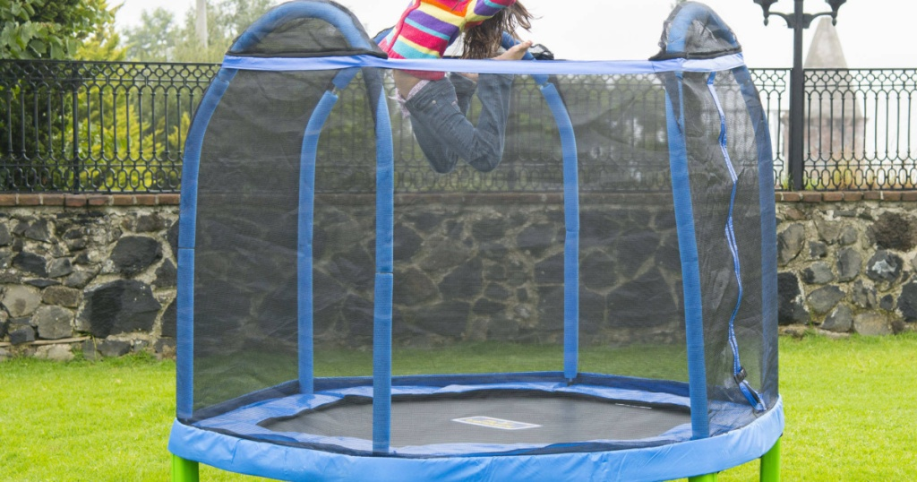 little girl jumping on bounce pro trampoline