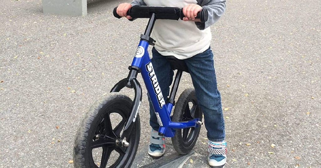 boy riding Strider 12 Balance Bike in blue