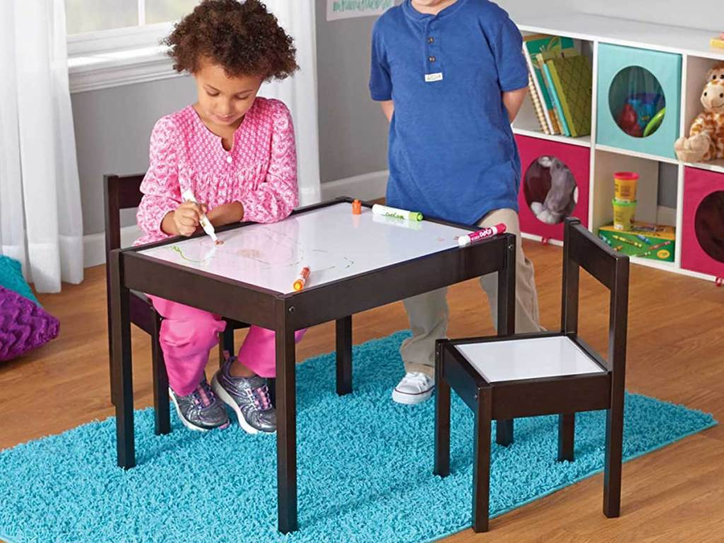 kids drawing on a dry erase table