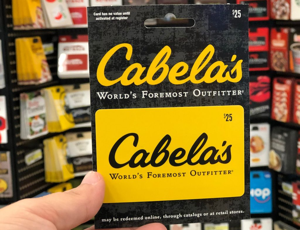 cabelas gift card in hand in store