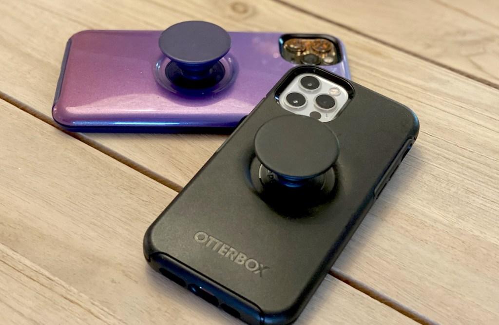 black and purple phones on table