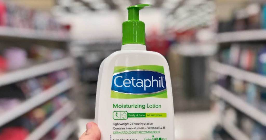 hand holding cetaphil lotion
