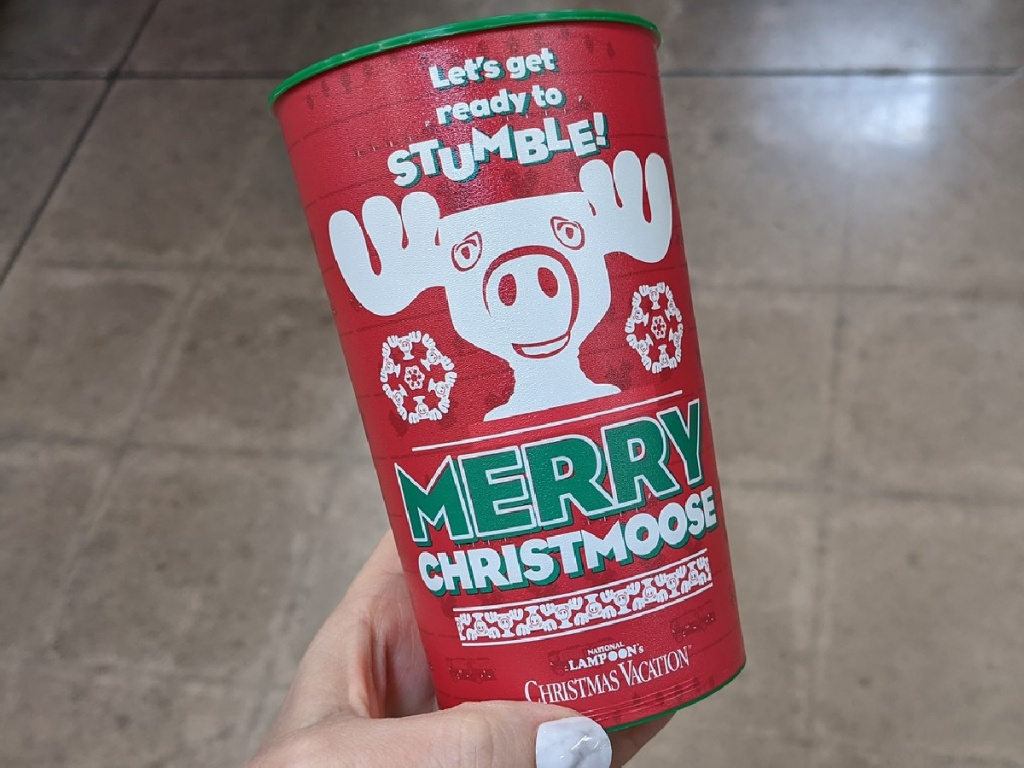 hand holding red Christmas cup