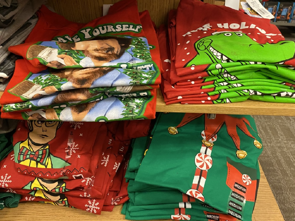 shelves in store with Christmas Tshirts