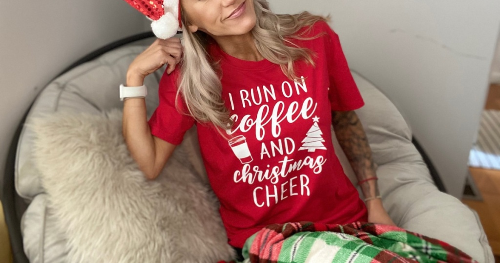 woman in santa hat with christmas tee red