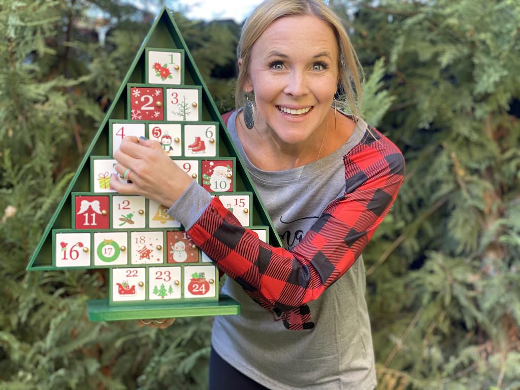 woman holding Christmas Advent Calendar outside