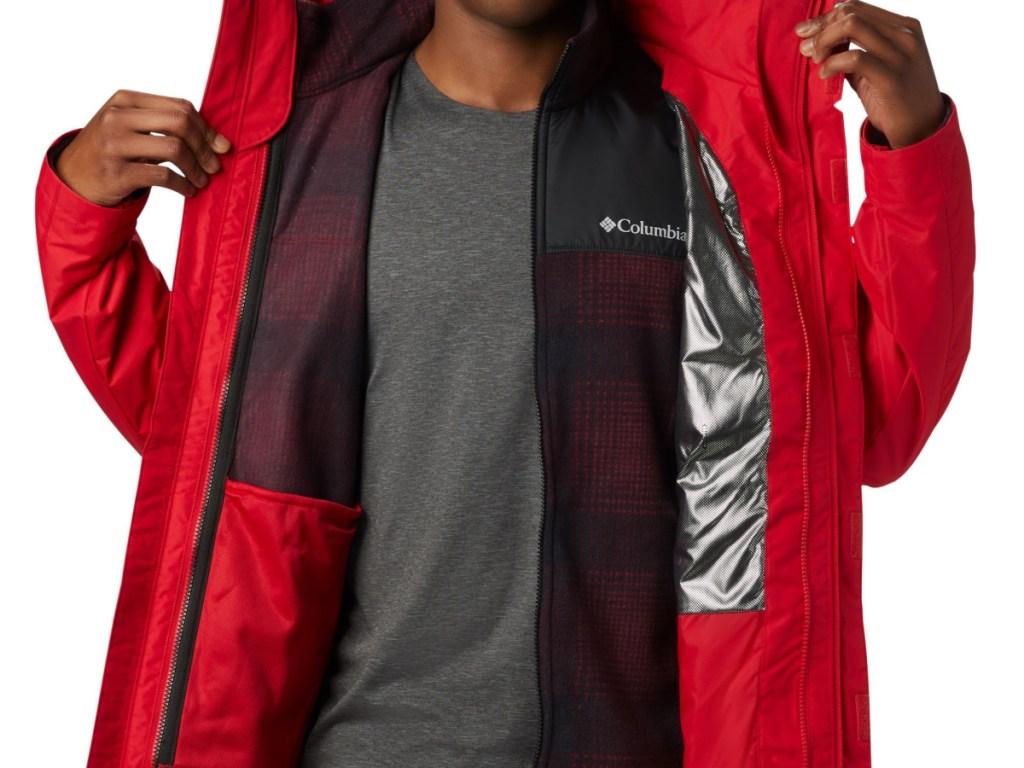 man's torso showing open red jacket he is wearing