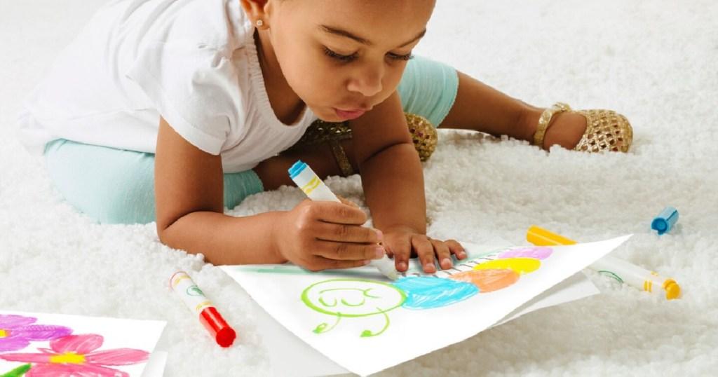 little girl using crayola color wonder