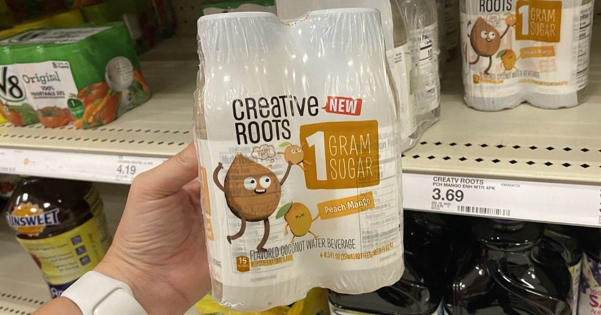 hand holding Creative Roots Coconut Water