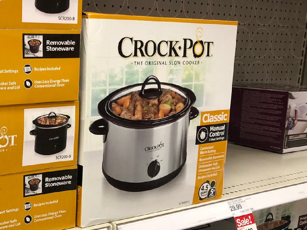 store shelf with boxes of crock-pots on it