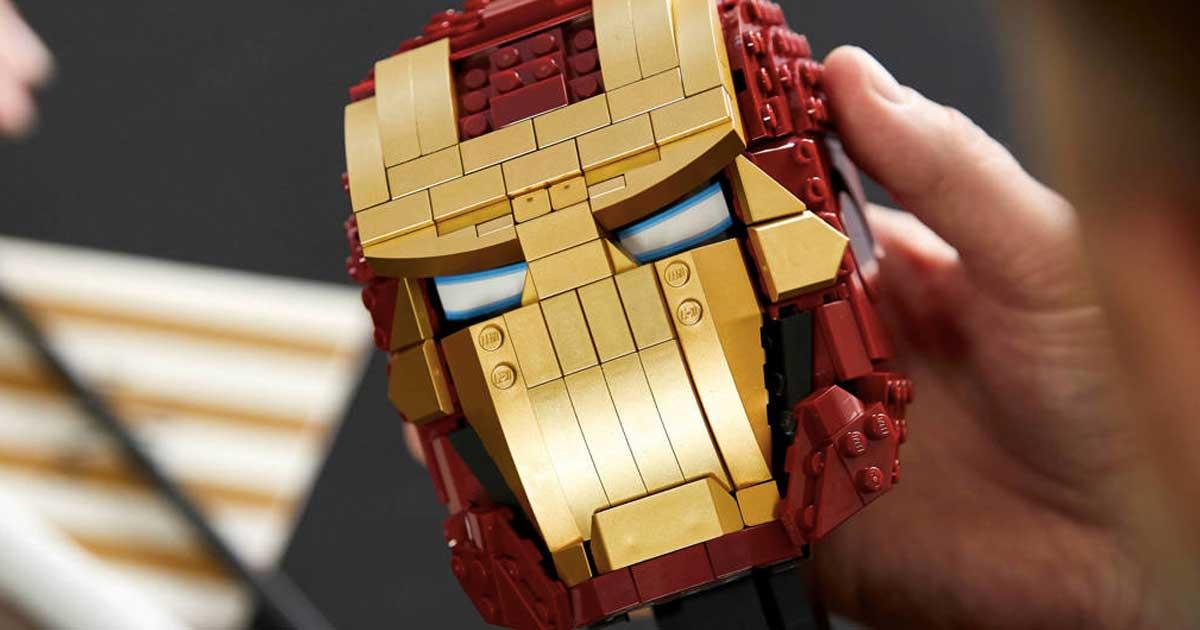 hand holding an iron man lego helmet