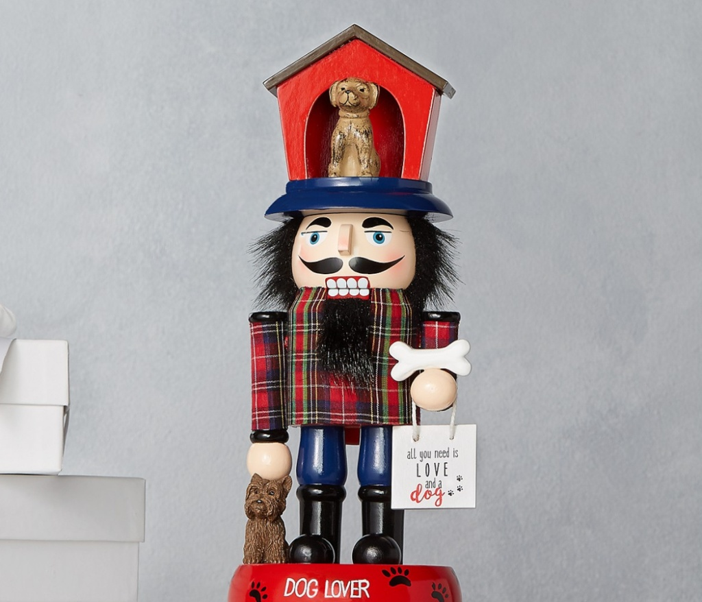 "nutcracker with dog house on head and ""dog lover"" written on base"