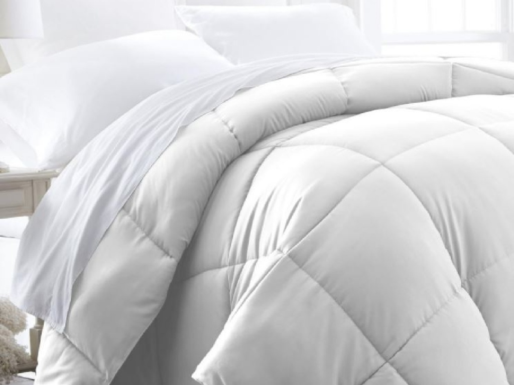 white comforter on bed
