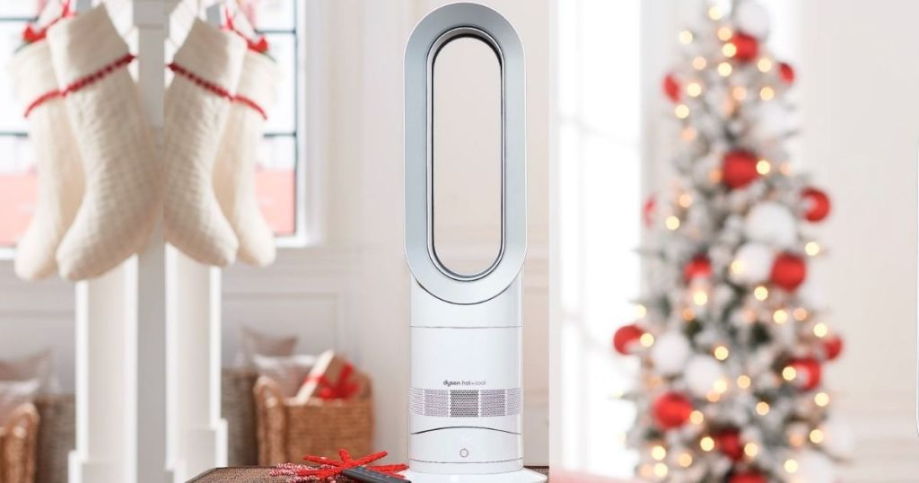 dyson silver fan with Christmas tree and stockings surround it