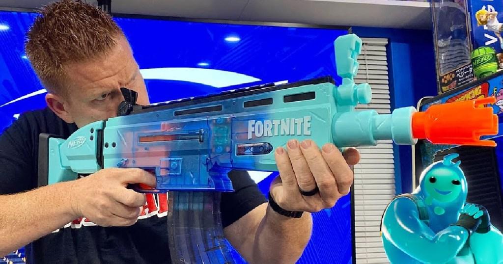 man holding fortnite blaster