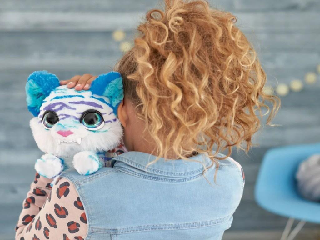 little girl holding a pet kitty