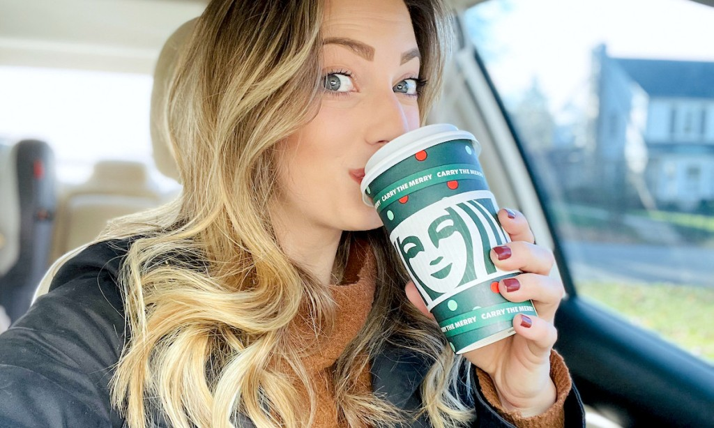 woman sipping from starbucks holiday cup