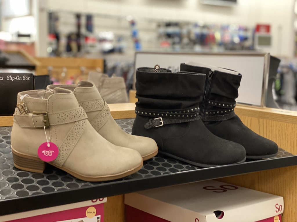 two pairs of little girls boots on store display
