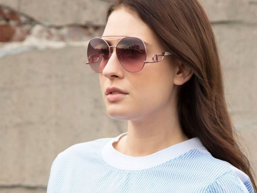 woman wearing sunglasses with long wavy hair
