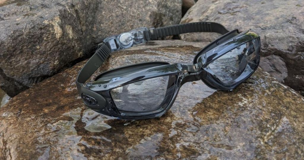 black and clear goggles sitting on rocks