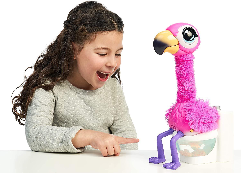 little girl playing with gotta go flamingo