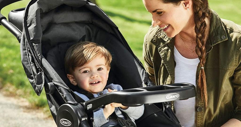 graco stroller little boy facing mom
