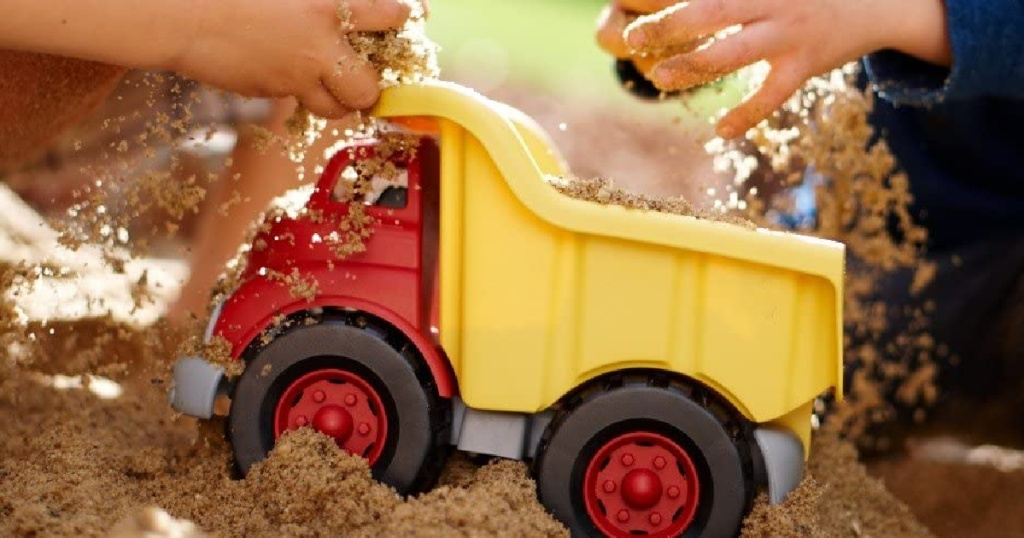 green toys dump truck with dirt in it