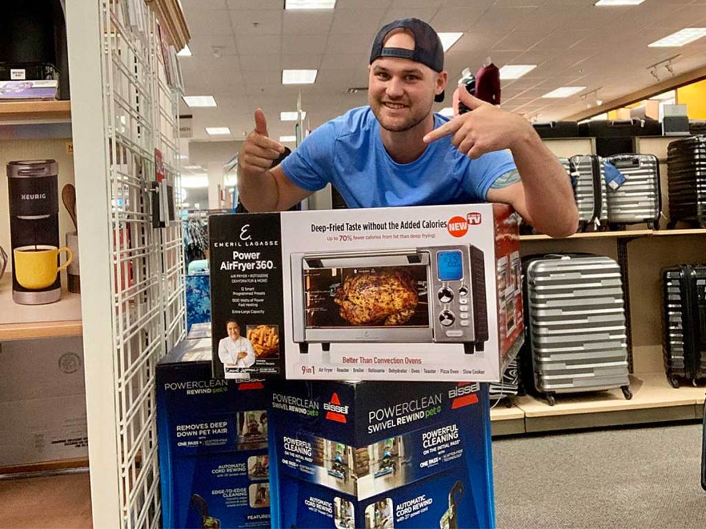 guy displaying a power air fryer in a store