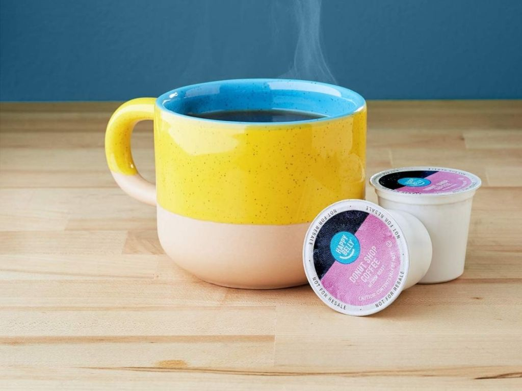 coffee cup and 2 coffee pods