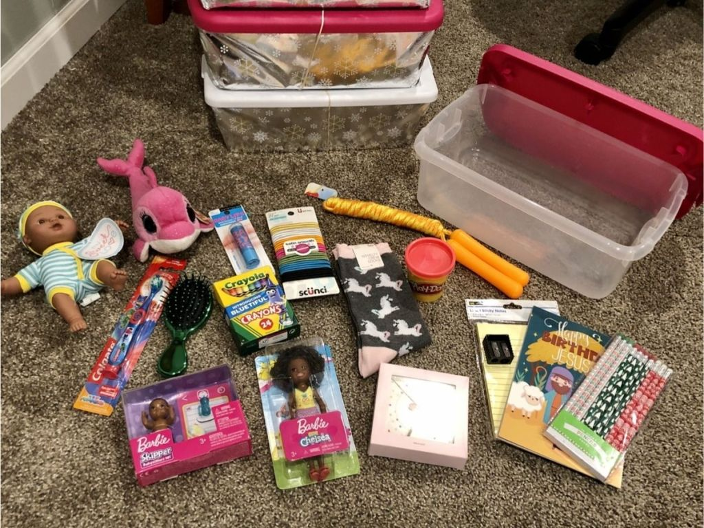 toys and children's necessities spread out on the floor