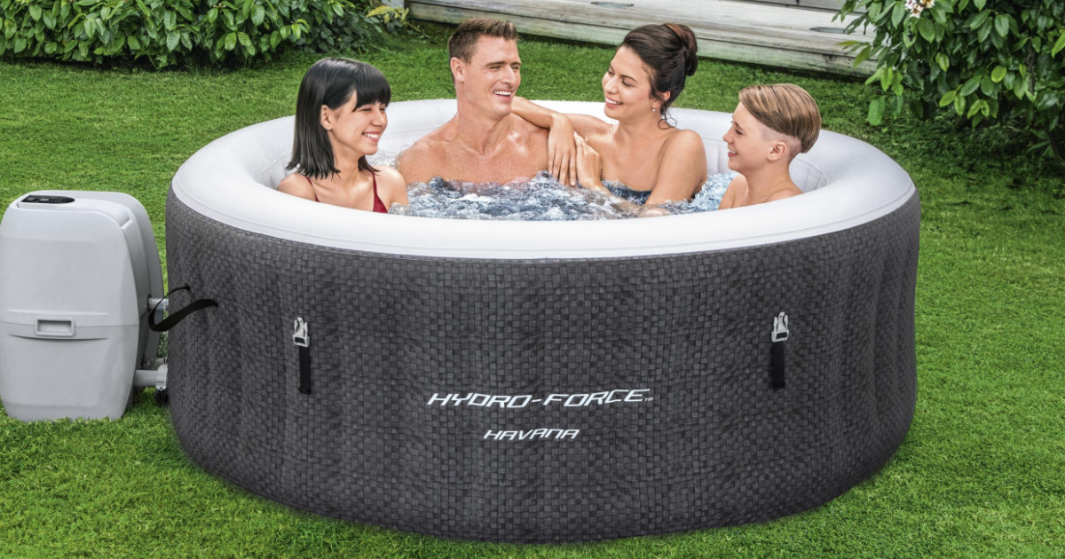 four people in hot tub on grass