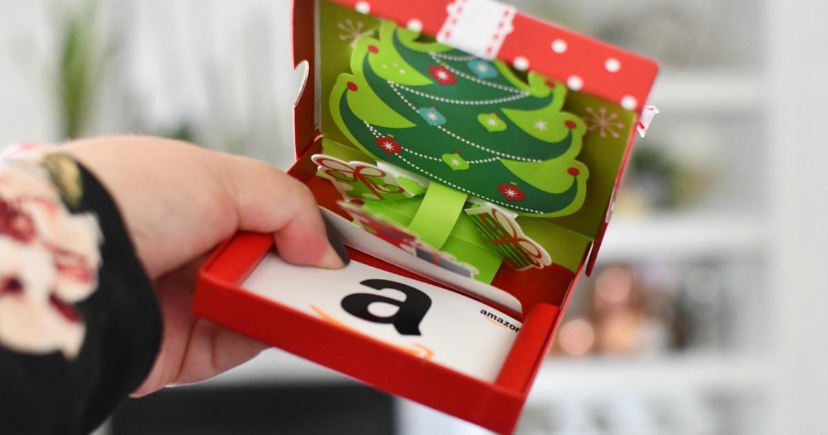 holding Amazon gift card box