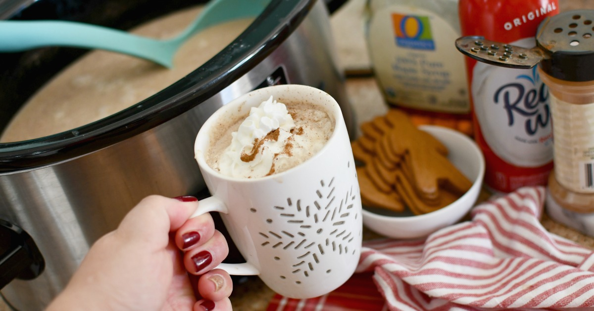 holding a cup of crockpot gingerbread latte