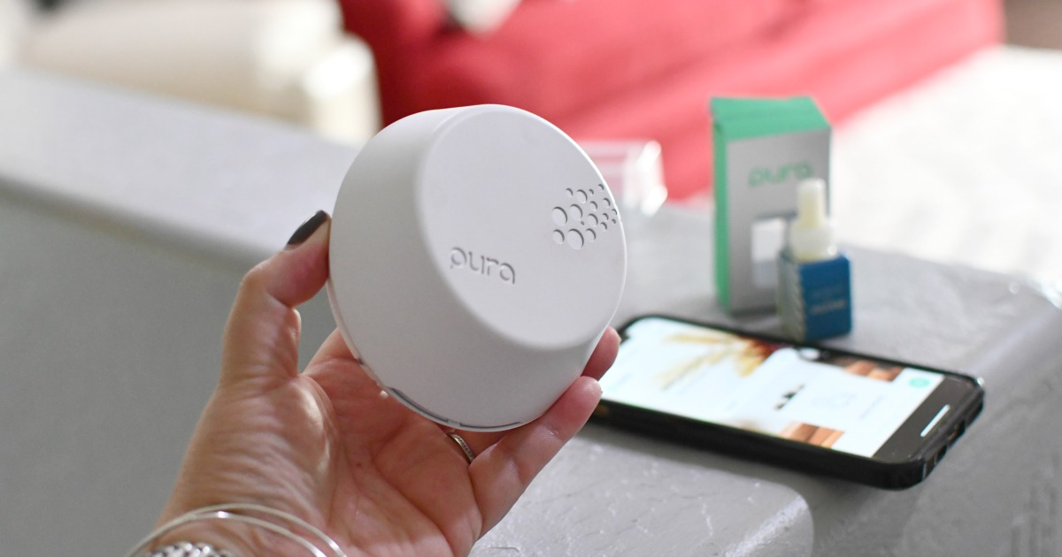 holding a pura smart diffuser