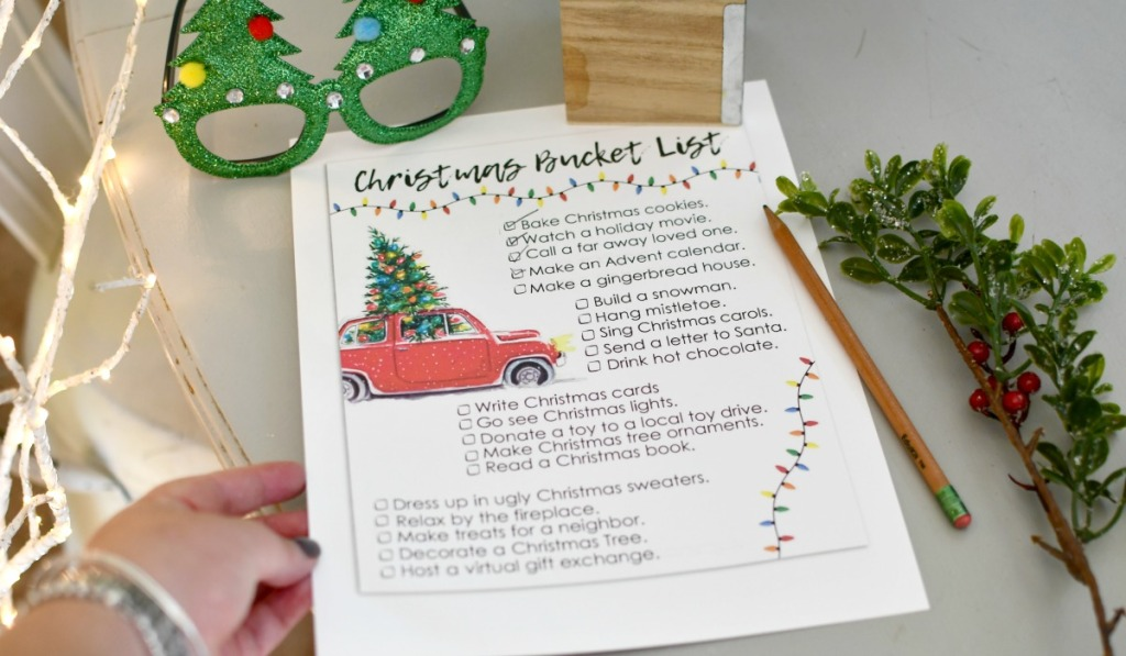 holding free printable christmas bucket list