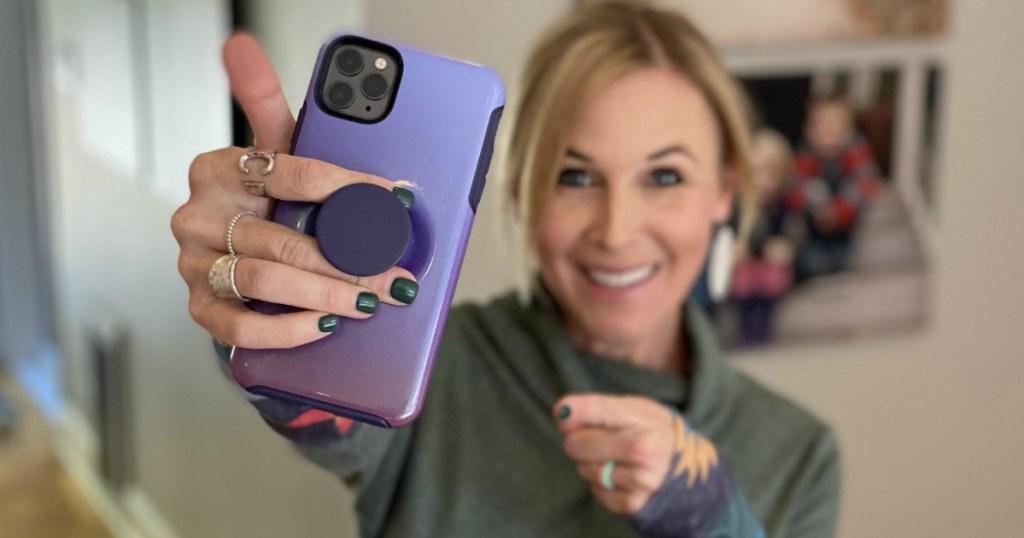 holding Otterbox pocketsocket iphone case
