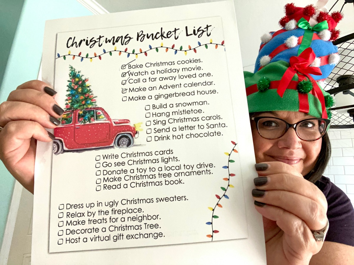 holding up a christmas bucket list