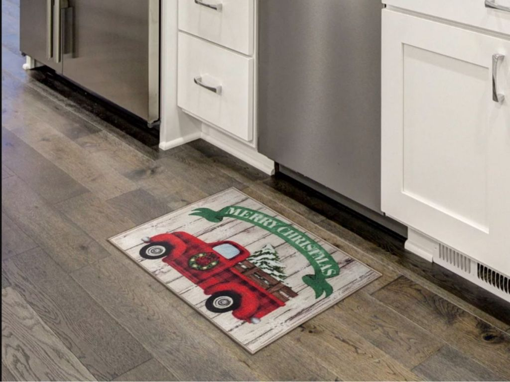 holiday accent rug in front of dishwasher