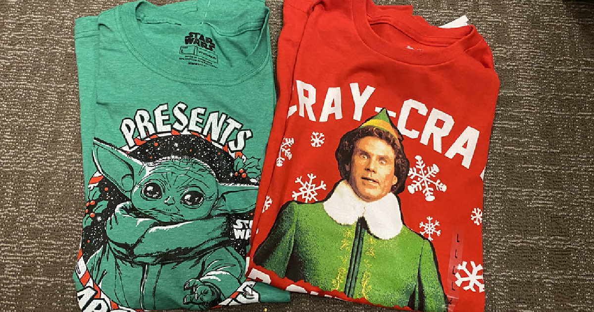 2 tshirts laying on floor with Chrismas themes